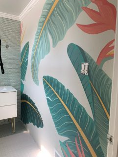 tropical palm wallpaper installed in a bathroom