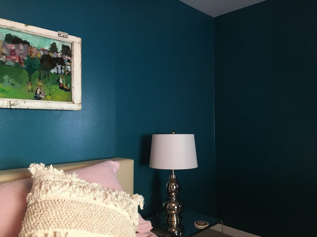 bedroom with shiny, teal walls