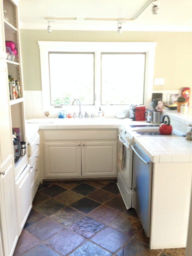 photo of a galley kitchen with white shaker cabinets