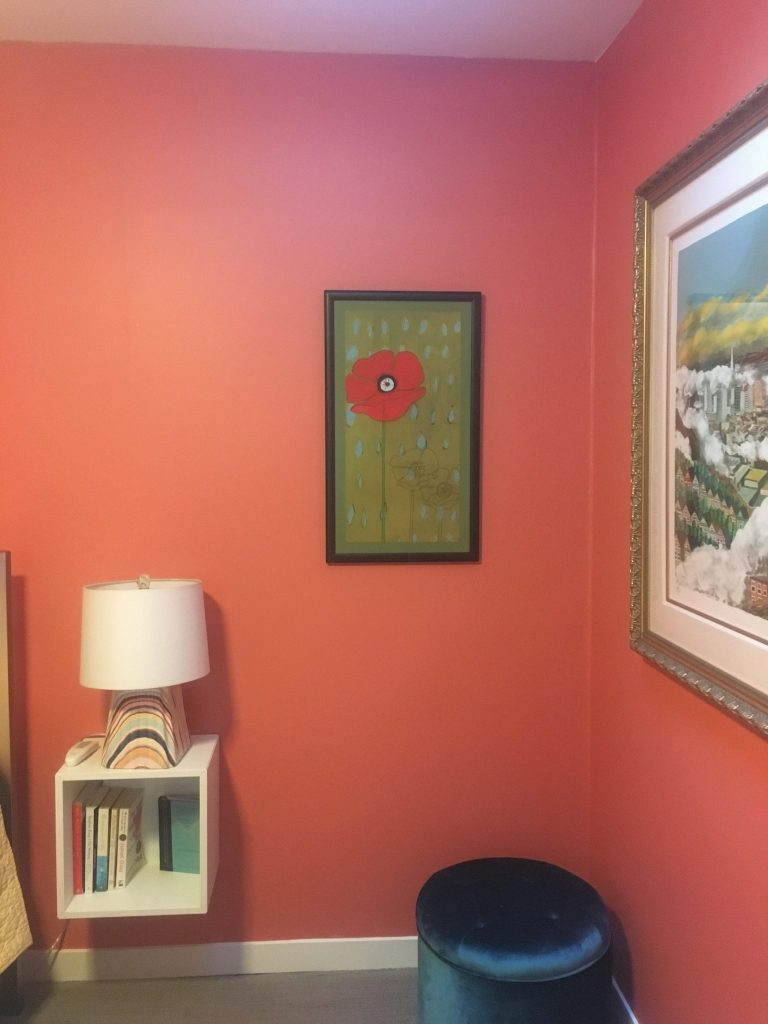 Room with coral paint and home decor touches