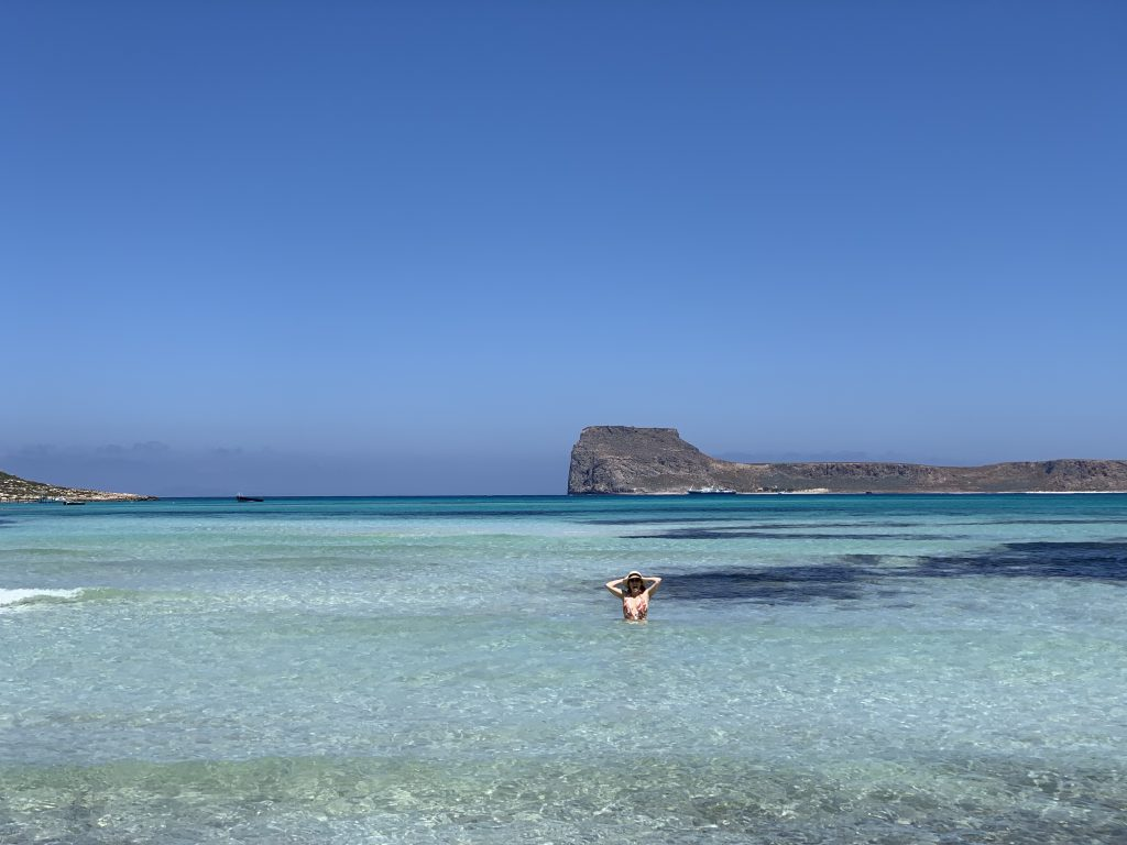 woman standing in crystal clear water