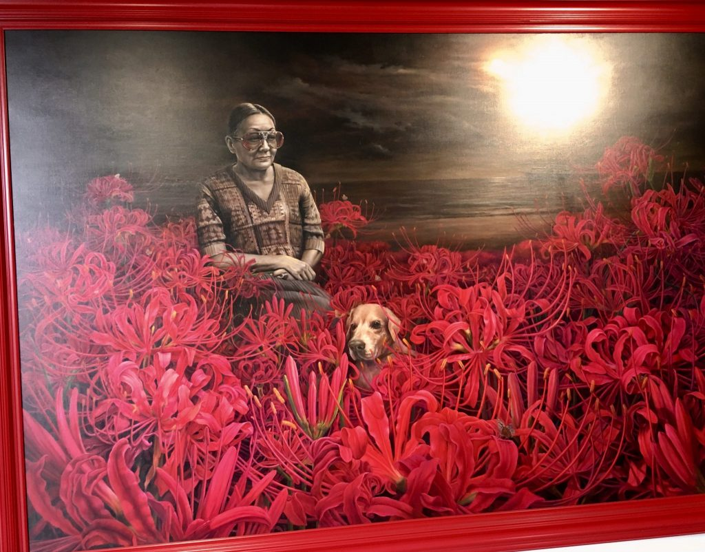 pink and grey oil painting hanging in maiiam museum of a woman and dog seated in pink flowers under the moon