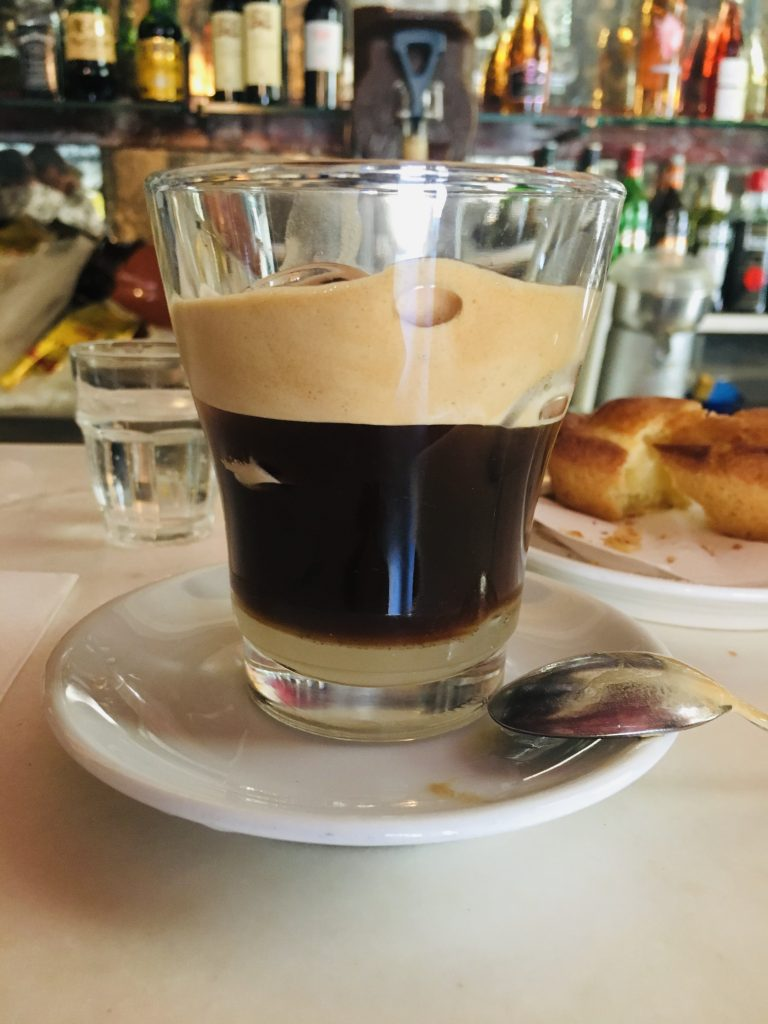 close up of a local specialty coffee in a clear glass