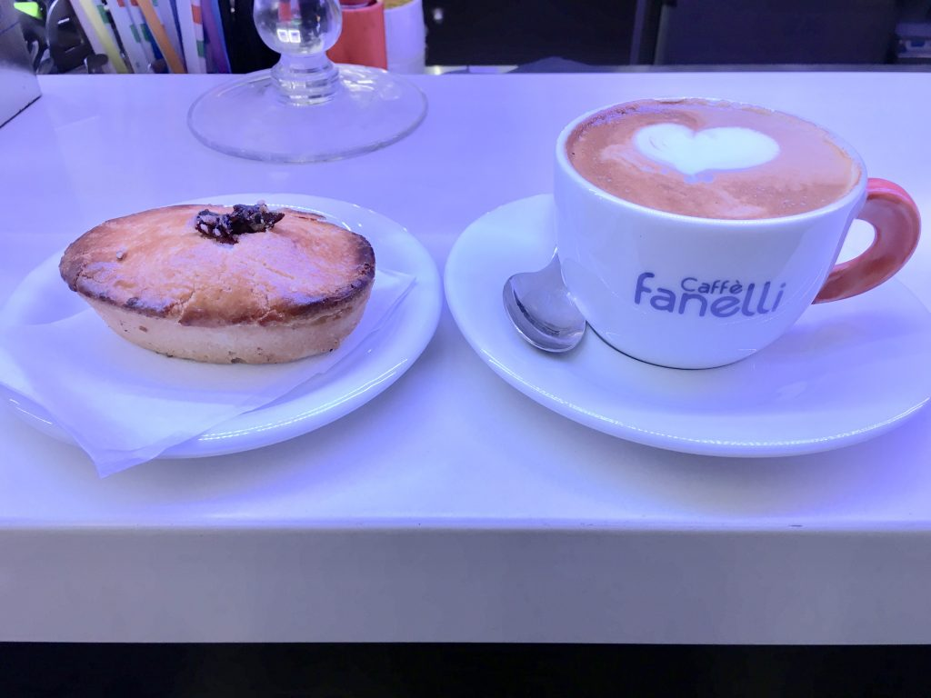 close up of a cappuccino and pasticciotto