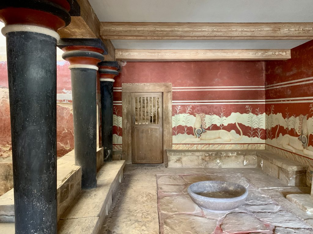 inner chamber of the palace of knossos with red mural painted wall