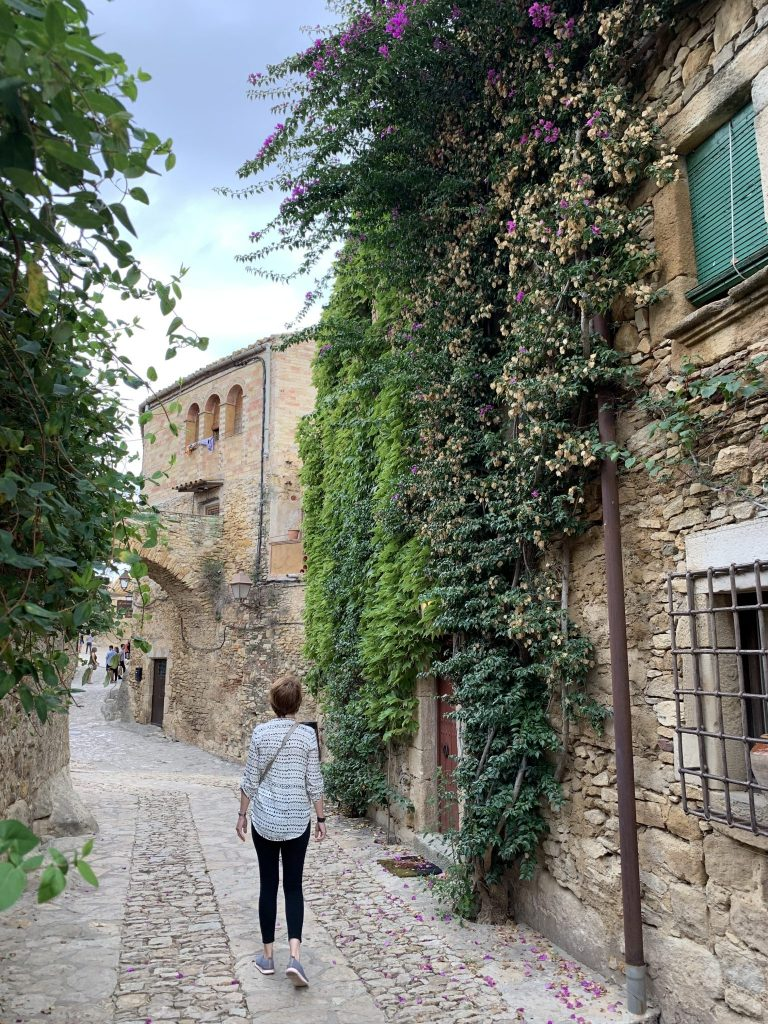 Woman walking through the town of Petrallada