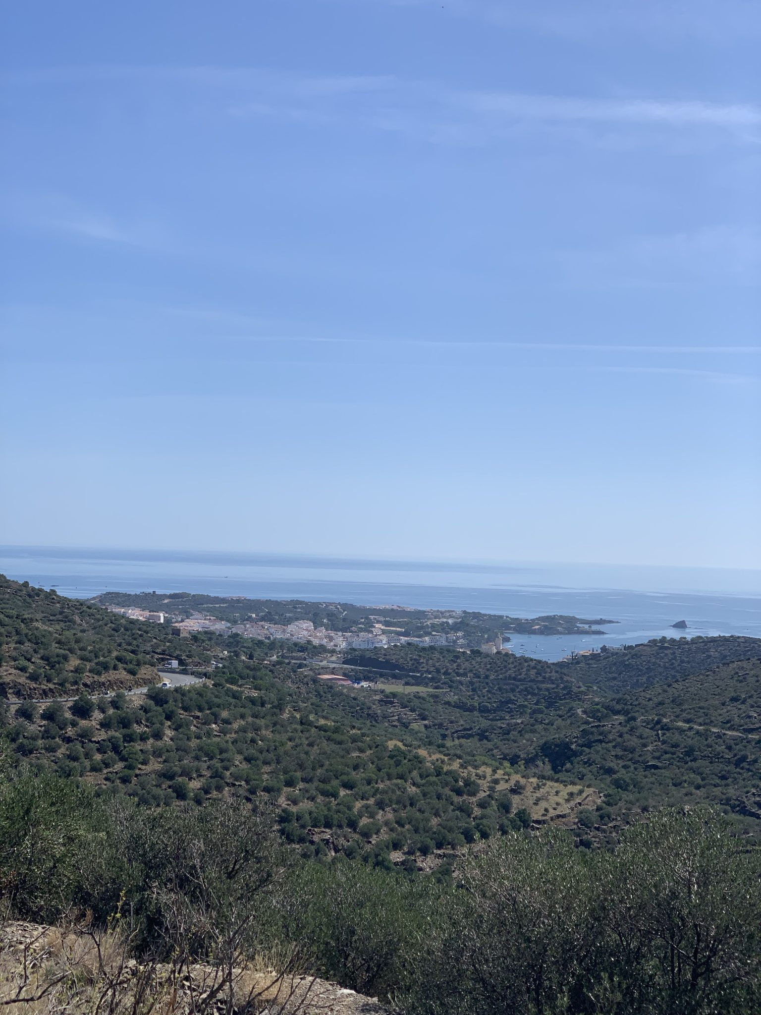 Scenic view from a mountaintop down to Cadaques and Mediterranean Sea.