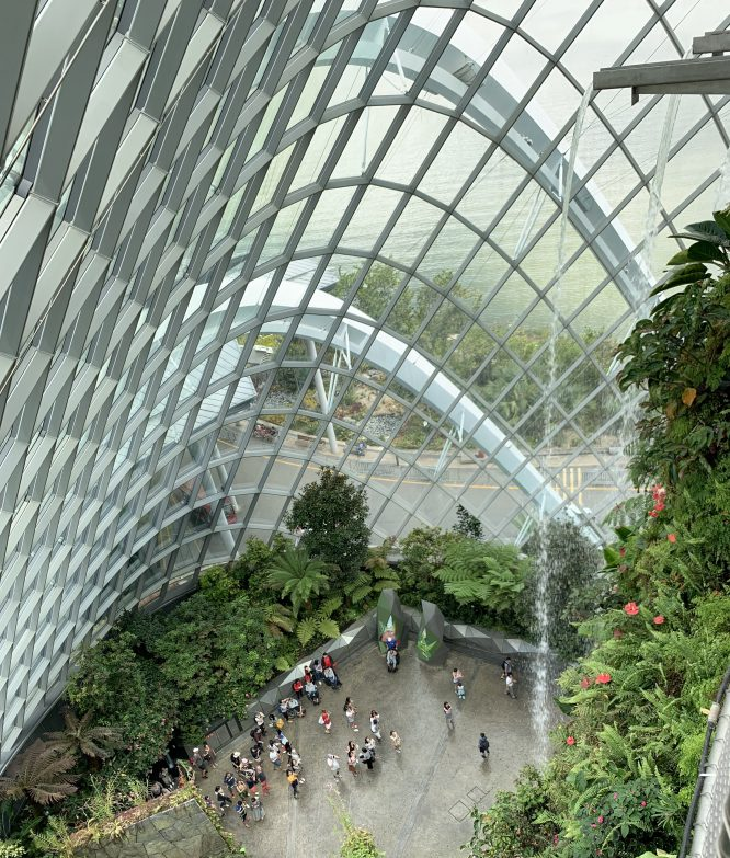 Glass enclosed waterfall overlooking Singapore Bay