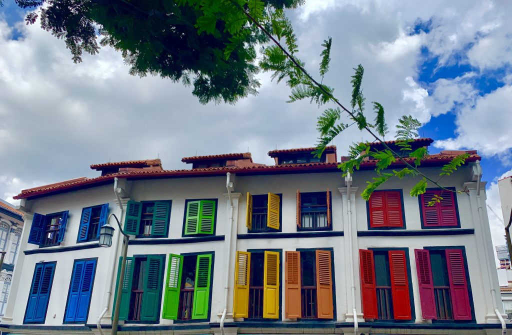 Row houses with colorful shutters.