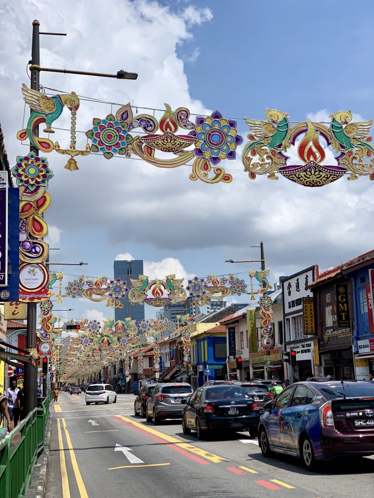 Festive banners hanging over a city street in Singapore
