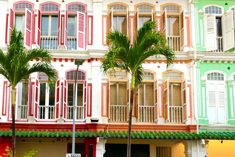 Colonial row houses with colorful trim
