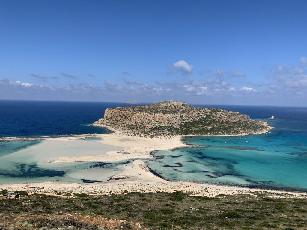 panorama of the turquoise waters and white sand of balos lagoon